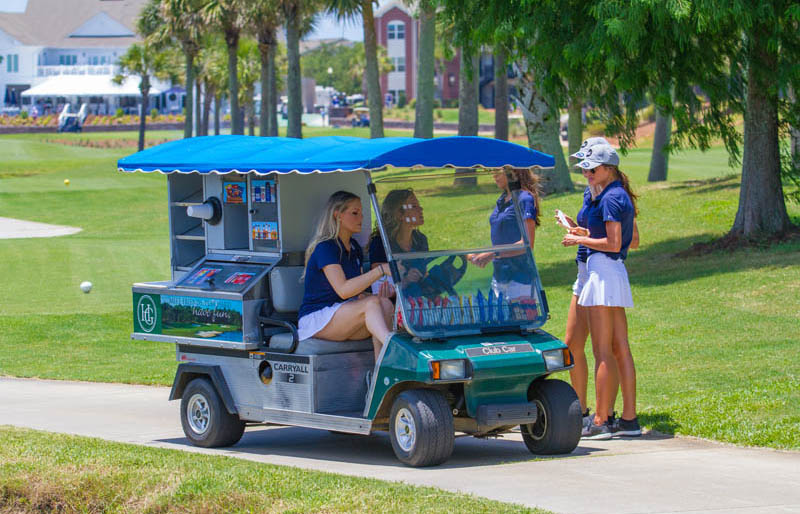Cart girls on cart path in golf cart